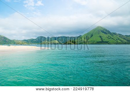 Coastline of Flores with green hills along the ocean and beach, Flores, Indonesia