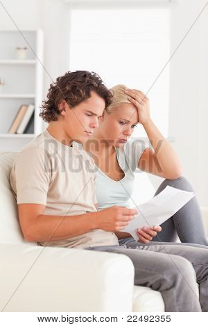 Unhappy Couple Reading Letters