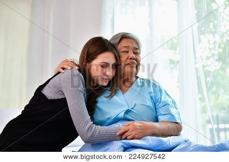 Patient Concept. Grandma's in the hospital. Waiting for someone to visit. Grandchildren visit grandma at the hospital. Grandma is happy to meet grandchildren.