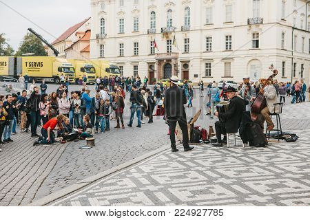 Prague, October 28, 2017: Street concert: musicians play on instruments next to the gathered audience near the Prague Castle