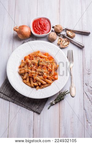 pasta with pumpkin tomato sauce nuts and sesame seeds