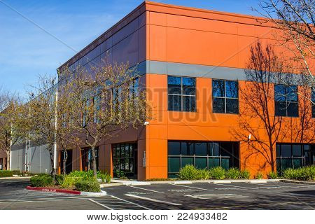 Corner Two Story Office Building With Bright Color