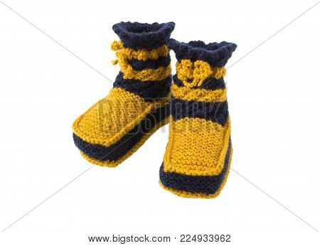 Knitted socks for the kid.  Knitted handmade woolen socks isolated on white background