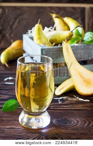 Freshly Squeezed Pear Juice And Ripe Pear On A Wooden Table. Top View. The Concept Of Nutrition For