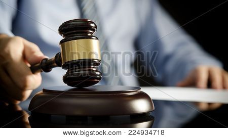 Lawyer In Office With Gavel, Symbol Of Justice