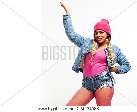 young pretty african-american girl teenage fancy swag dressed, posing emotional happy smiling isolated on white background, lifestyle people concept close up