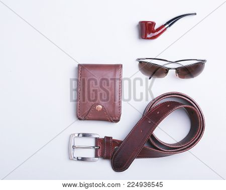 Men's accessories for business and rekreation. A professional studio photograph of men's business accessories. Top view composition.
