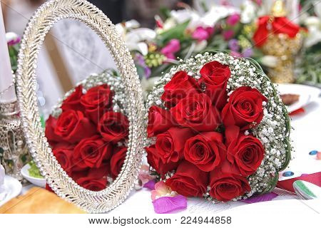Valentines day concept. A bouquet of flowers bouquet of a red roses. Red bouquet of red roses at wedding . Bridal red wedding bouquet .