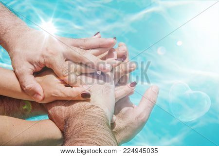Man and woman hands overlapped, multiple concept of people joined together, team, friendship, community, relationship.