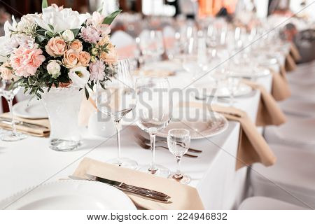 Tables set for an event party or wedding reception. luxury elegant table setting dinner in a restaurant. glasses and dishes