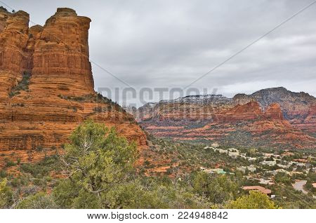 The city of Sedona Arizona under its famous Coffee Pot Rock.