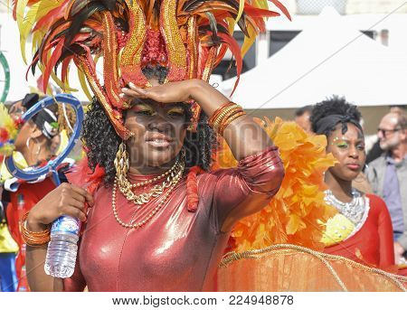 LE MANS, FRANCE - APRIL 22, 2017: Festival Evropa jazz A Carnival dancer on the parade. Woman dancing in Caribbean costumes