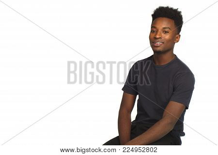 young man sitting cool attitude handsome person studio white background
