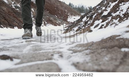 Close-up Of Male Legs In Winter Shoes Walking On Snow. Footage, View Of Walking On Snow With Snow Sh