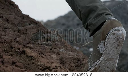 Close Up Of Hiking Boots And Legs Climbing Up Rocky Trail. Close Up Climber Legs Make A Last Steps B
