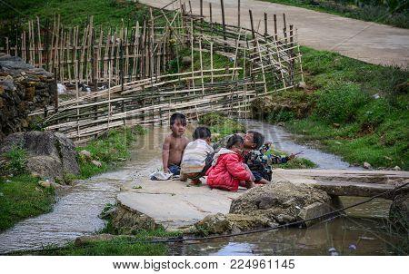 Sa Pa, Vietnam - May 31, 2016. Children Playing At Poor Village In Sa Pa, Vietnam. Sa Pa Is A Mounta