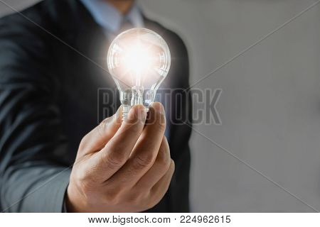 Busines Concept Saving Energy. New Idea Inspiration And Innovation