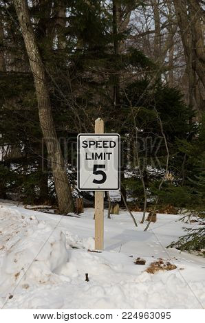 Sign to let drivers know the speed limit is 5 miles per hour.