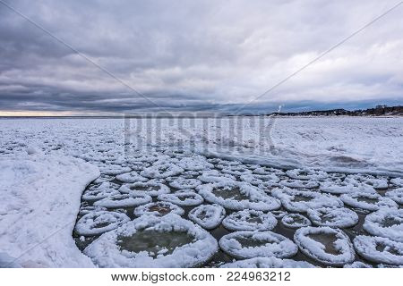 Chunks of ice shaped like donuts in Lake Michigan