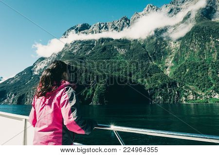 Woman Tourist On Ship Deck In Milford Sound