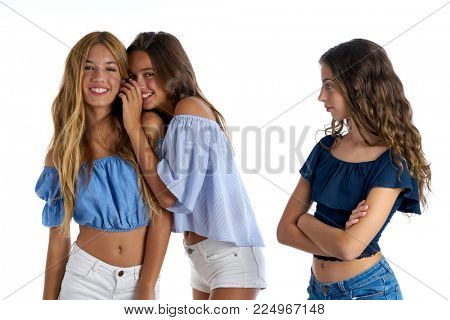 Teen best friends bullying a girl sad apart out of the game on white background
