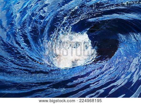 The raging whirlpool on surface of the deep river