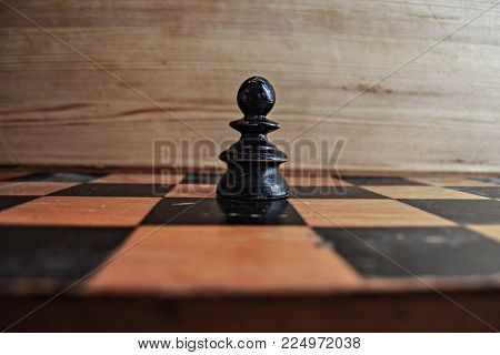 Chess photographed on a chessboard/ wooden chess pieces/ closeup/ conceptual photography