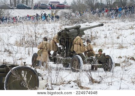 SAINT PETERSBURG, RUSSIA - JANUARY 14, 2018: The female crew of an antiaircraft gun prepares for fight.  Fragment of the military-historical festival