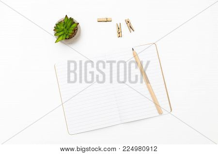 Notebook and pencil on white background. Scandinavian style