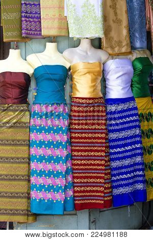 Assortment of colorful women sarongs for sale in local market, Yangon, Myanmar, Burma. Close up
