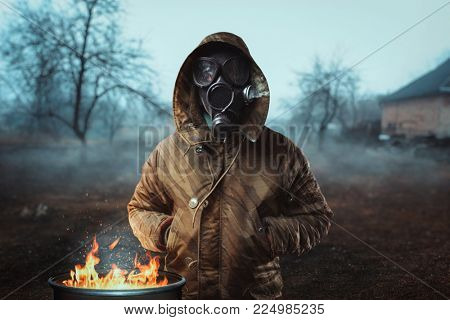 Stalker soldier in gas mask against fire, doomsday