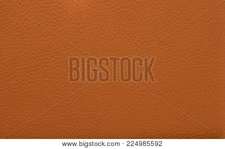Orange leather background. Red leather texture. Toned leather book cover closeup. Natural leather surface for banner background. Logo or brand identity mockup. Shoes and handbag material. Animal skin