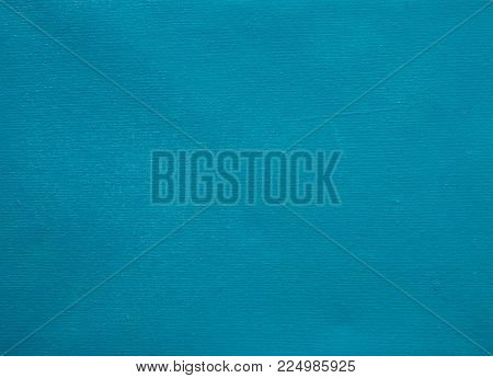 Blue canvas background. Stretched canvas rough texture. Blue teal painted canvas for navy banner template. Grungy fabric texture. Textile weaving pattern. Toned gunny texture. Vintage ragged surface