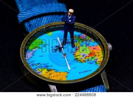 Businessman figurine on global map watch. Worldwide business concept. Businessman macro photo. Strategic planning for global corporation. Global success in business. Precious time or jet lag concept