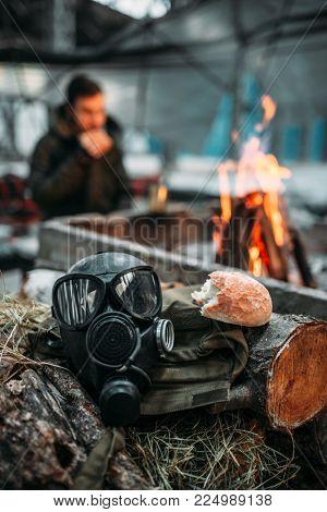 Gas mask against fire, stalker eats on background
