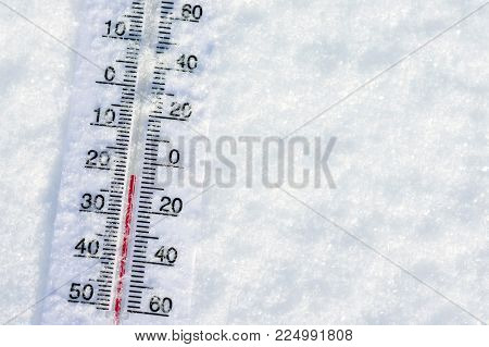 Thermometer in pure snow in frosty weather
