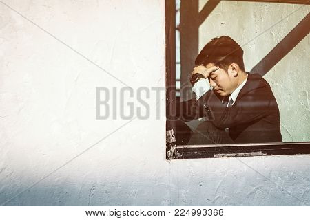 A Stressed Out Business Man Holds His Head In Despair As He Fears That He Will Have To File For Bank