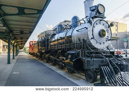 Nebraska, USA - Aug 8, 2017: Chicago Burlington & Quincy Locomotive #710, at Lincoln Station in the Haymarket district. Open to mainly pedestrian traffic, the district has a strong railroading heritage.