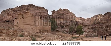 PETRA, JORDAN - JANUARY 26, 2017: Large panoramic view of Ruins of Great Temple in the ancient Arab Nabataean Kingdom city of Petra. Jordan