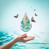 World ocean day,, saving water campaign, sustainable ecological ecosystems concept with green earth on woman's hands on blue sea background : Element of this image furnished by NASA poster