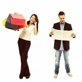 Stereotype of gender. Businessman reading economic newspaper and girl with colorful shopping bags talking on phone isolated. Modern man and woman. Studio shot. poster