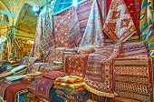 The Persian carpets are popular gift from Iran, Vakil Bazaar of Shiraz offers large amount of kilims and rugs, Iran. poster
