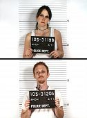 Police mug shots of a male and female criminal holding a placard, standing in front of a white rulered wall. poster