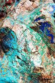 A close-up look at the intense greens and blues of malachite and azurite in Arizona's copper ore deposits. poster