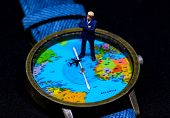 Businessman figurine on global map watch. Worldwide business concept. Businessman macro photo. Strategic planning for global corporation. Global success in business. Precious time or jet lag concept poster