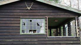Vandals Have Broken Windows In An Old House