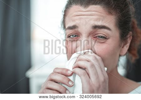 Green-eyed Woman Drying Her Running Nose After Strong Allergy