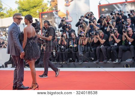 Tina Kunakey and Vincent Cassel on the red carpet for the screening of 'J'Accuse (An Officer And A Spy)' during the 76st Venice Film Festival at the 30 on August Sala Grande, 2019 in Venice, Italy.