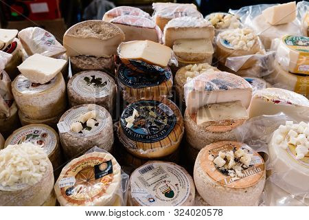 Cangas De Onis, Spain - March 31, 2019: Assortment Of Traditional Asturian Cheeses Ready To Taste In