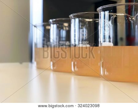 Waste Water Sample In Beakers Coagulation And Flocculation Method With Ferric Chlorine And Using Jar